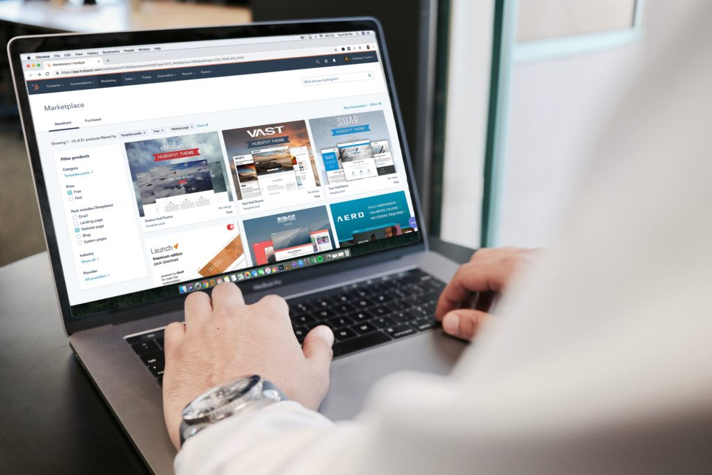 person using a laptop that is showing a marketplace for shopping